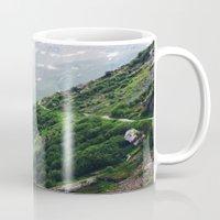 switzerland Mugs featuring Switzerland by Tana Helene