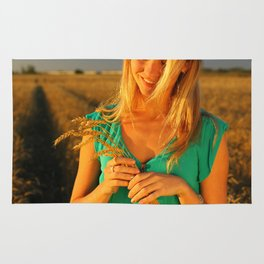 girl on the field Rug