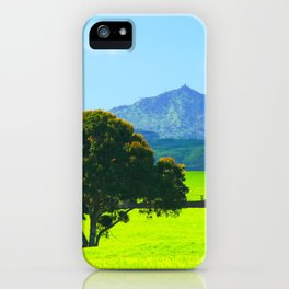 green tree in the green field with green mountain and blue sky background iPhone Case
