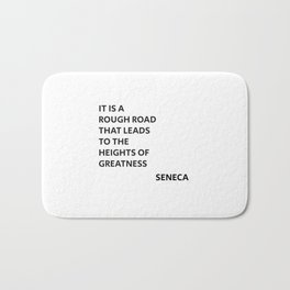 IT IS A ROUGH ROAD THAT LEADS TO THE HEIGHTS OF GREATNESS - SENECA STOIC QUOTE Bath Mat