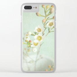 White and yellow delicate flowers against a pale green background. Clear iPhone Case