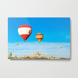 Colorful hot air balloons flying near Uchisar castle at sunrise, CappadociaTurkey Metal Print