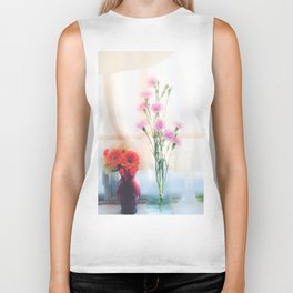 pink flower and orange flower in the vase with curtain background Biker Tank
