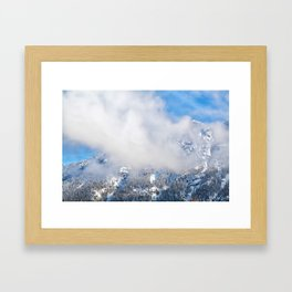 Mountain peaks in low winter clouds Framed Art Print