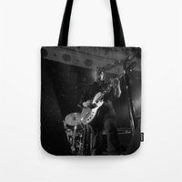queens of the stone age Tote Bags featuring josh homme // queens of the stone age by Hattie Trott
