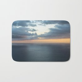 Dramatic sky and beautiful sunset over Atlantic ocean in Madeira island, Portugal. Bath Mat