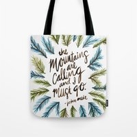 the mountains are calling Tote Bags featuring Mountains Calling by Cat Coquillette