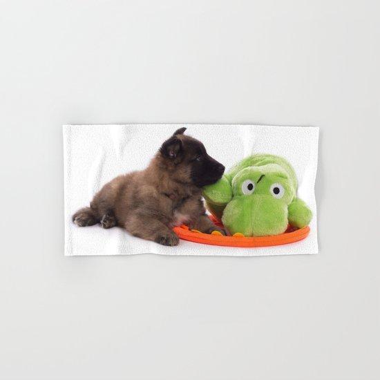 Puppy cuddling green toy Hand & Bath Towel