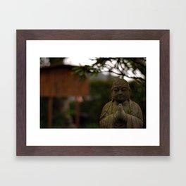 praying buddah Framed Art Print