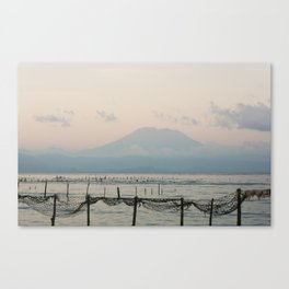 Seaweed fields and Bali in the mist Canvas Print
