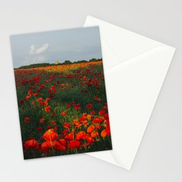 Church and field of red poppies in evening light. Holme Hale, Norfolk, UK Stationery Cards