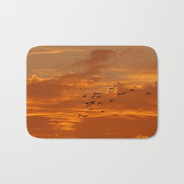 Birds and sunset Bath Mat