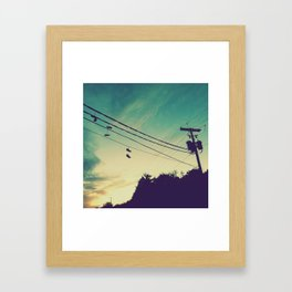 Sneakers On A Wire Framed Art Print