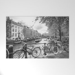 Bicycles parked on bridge over Amsterdam canal Welcome Mat