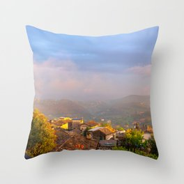 SUnset over the old roofs Throw Pillow