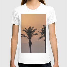 Sun through the mountains and palms at the beach. T-shirt