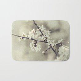 crossed blossoms Bath Mat