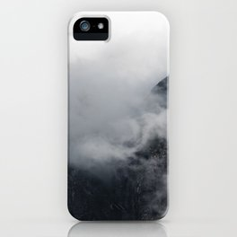 White clouds over the dark rocky mountains iPhone Case