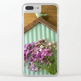 Birdhouse flatlay with wildflowers Clear iPhone Case