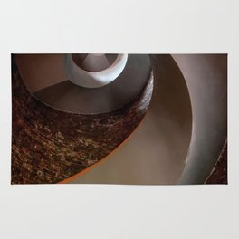 Spiral staircase in an old lighthouse Rug