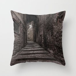 Medieval street that goes up narrow towards Bergamo Alta in the night Throw Pillow