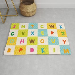 alphabet  from A to Z. Polka dot background with green blue orange square Rug