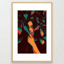 Woman looks trough leaves Framed Art Print
