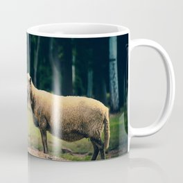 Sheep on a mountain in the forest Coffee Mug
