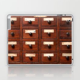 Backgrounds and textures: very old wooden cabinet with drawers Laptop & iPad Skin