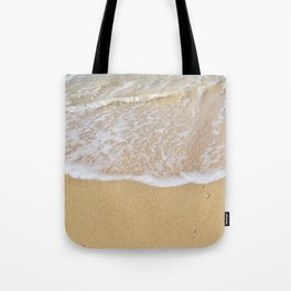 Beautiful wave surfing on a sandy beach Tote Bag