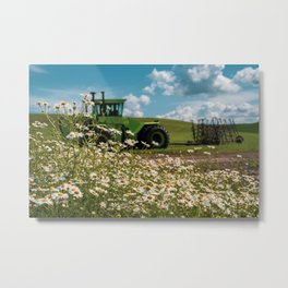 Daisies and a green tractor (defocused) in the Palouse Metal Print