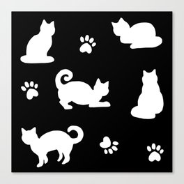 White Cats and Paw Prints Pattern on Black Canvas Print