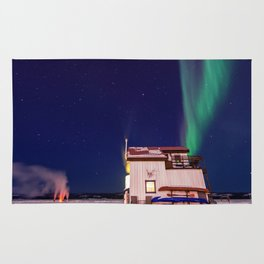 Northern Lights and house boat in Yellowknife Rug