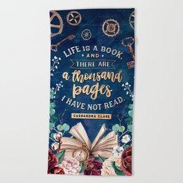 Life is a book Beach Towel