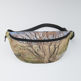 Tree at dam in winter Fanny Pack