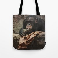 newspaper Tote Bags featuring bored chimpanzee after reading newspaper by UtArt