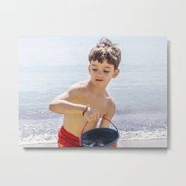 Young boy playing on a beach in French Riviera Metal Print