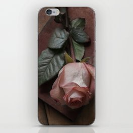 Pink rose and red old book iPhone Skin