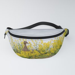 Female Mallard enjoying the yellow flowers Fanny Pack