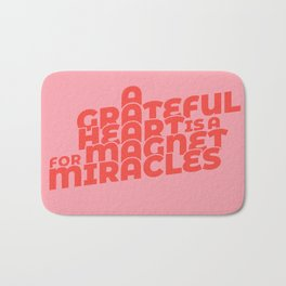 magnet for miracles Bath Mat