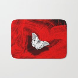 Silver butterfly emerging from the red depths Bath Mat