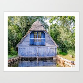 Thatched boat house on the river Art Print