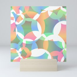 Abstract soap made of cosmic transparent blue circles and green bubbles on a light background. Mini Art Print