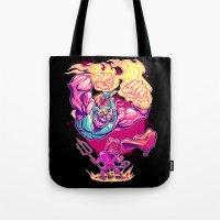 diablo Tote Bags featuring LUCHADORO VS EL DIABLO by BeastWreck