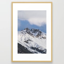 Clouds roll over the snow covered mountains of Innsbruck in Austria. Framed Art Print