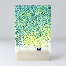 Cat in the garden under willow tree Mini Art Print
