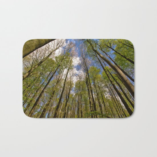 looking up to the trees in the forest Bath Mat