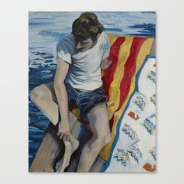 Man in bathing suit lounging on beach towel Canvas Print