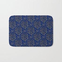 Gold Monstera on Blue Bath Mat
