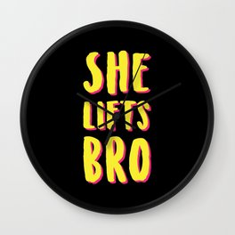 She Lifts Bro Wall Clock